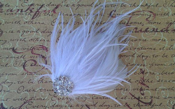 Hey, I found this really awesome Etsy listing at https://www.etsy.com/listing/95101666/bridal-feather-hair-piece-white-feathers
