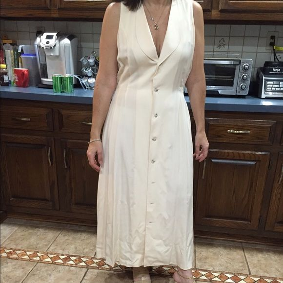 Sleeveless Silk full length cream color dress Sexy summer beach party dress. 100% silk. Button all the way down. I'm 5'2 and it goes to my ankles to wear with flats or heals!  Worn twice excellent condition- no stains. Dresses Maxi
