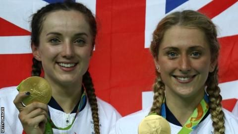 Gold medallists Elinor Barker (L) and Laura Trott (R) celebrate their women's team pursuit success