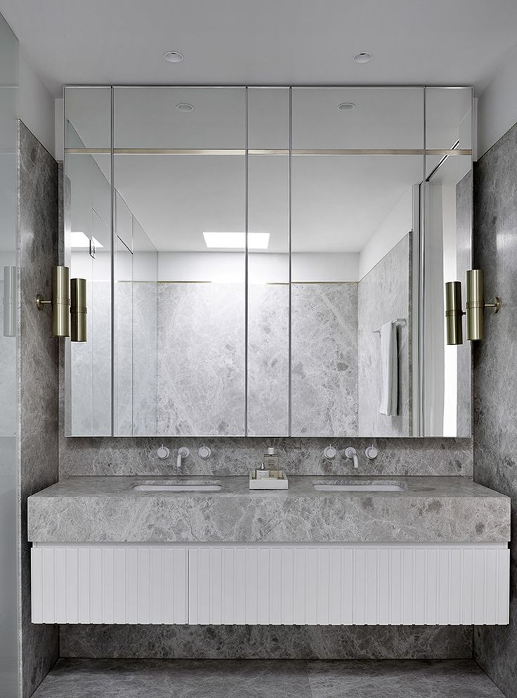 A Melbourne Midcentury Gets a Palm Springs-Inspired Revival - Dwell #palmsprings #bathroom #marble