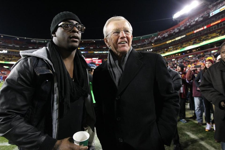 Redskins-Cowboys Week 17 - former RB Clinton Portis and Former Coach Joe Gibbs  - - before the game.