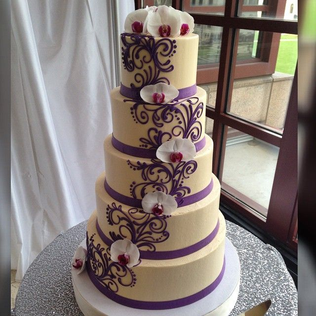 """5 tier Buttercream wedding cake with fresh flowers. #whiteflowercakeshoppe #makingclevelandsweeter #buttercreamlove #buttercream #buttercreamcakes #lovewhatwedo #ilovebuttercream #clevelandweddings #clevelandgram #216 #Cleveland #cakestagram #cakesofinstagram #instacake #purple #flowers"" Photo taken by @whiteflowercakeshoppe on Instagram, pinned via the InstaPin iOS App! http://www.instapinapp.com (03/25/2015)"