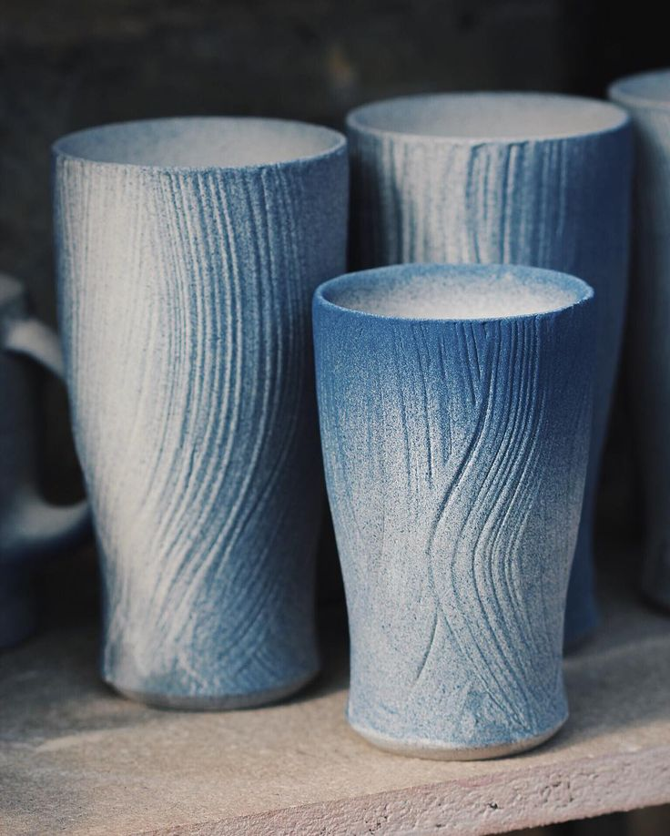 Hakame brushed beer cups large and small. Complete after having a thin layer of cobalt and black stain sprayed over. The taller ones are thrown to a height of eighteen centimeters for a sense of their size. The different gradients will leave varying strengths of blue once fired those areas heavily sprayed such as around the rim of the smaller piece will likely be very dark and glassy. The sinuous brush marks beneath can be completely obliterated by thick soda accumulating to the point where…
