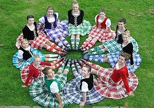 dancers in circle, make sure feet are perfect before kilts