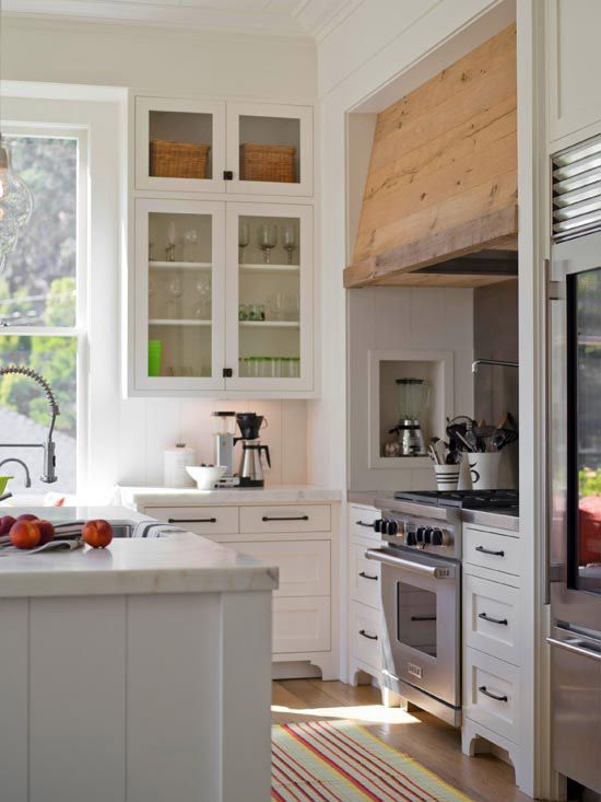 """Love the current trend of """"re-use"""" or """"re-purpose"""".  These homeowners used left-over oak flooring and had the metal range hood covered with it to create cohesion with the kitchen floors!  Fantastic idea (Better Homes)"""