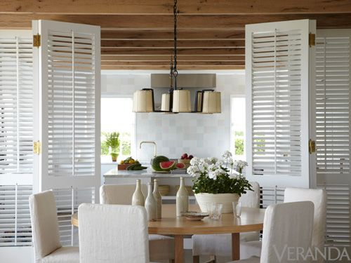 Neat idea--Shutters separate kitchen from dining. Ike Kligerman Barkley's Relaxed Beach House