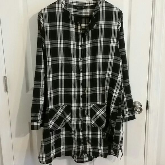 Plaid tunic Black and white plaid tunic. Collar less. Tie waist. Light weight. Button down front. Two front pockets. Length from shoulder hem is 34in. Sleeve length 25 in. Bust armpit to armpit is 23in. Dorothy Perkins Tops Tunics