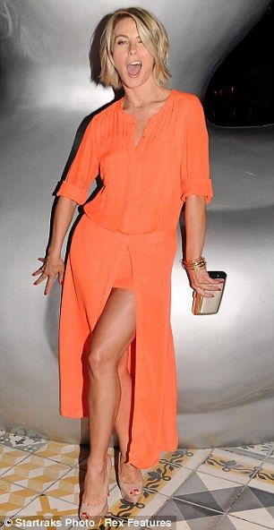 Feeling playful: Julianne flashed her toned legs in a tangerine maxi dress whilst attending the 2013 Conde Nast Traveler Hot List Party on Thursday night