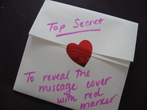 Secret Love Note - a secret message is revealed when you color over the white crayon writing with red marker.  This would be so fun to send to your husband at his work address for Valentine's Day!  I would include the red marker!  :)