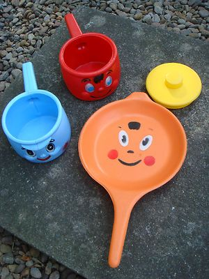 Vintage 1970's Mothercare toy pans -mine were really smelly, probably a result of mud pies and talcum powder soups.