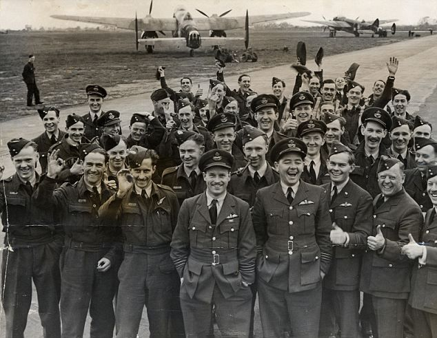 Guy Gibson, centre, with the air crews who took part in the raid on Germany. Gibson won the Victoria Cross for his bravery during the attack