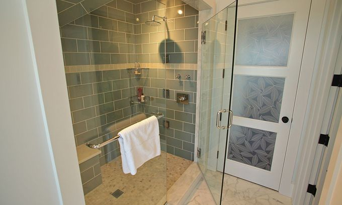 "tiled shower - a bit larger than ""standard"" tiny showers - also love the door (might be nice to replace toilet closet door with a door that has frosted glass panels)"