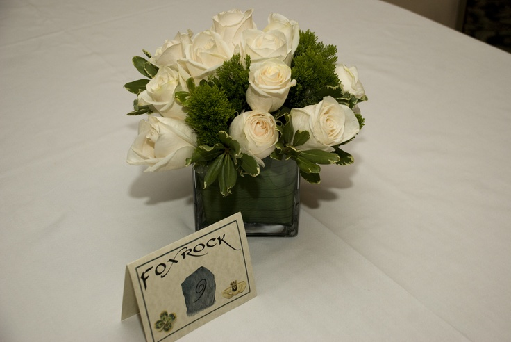 table card and centerpiece that matches bridesmaids bouquets
