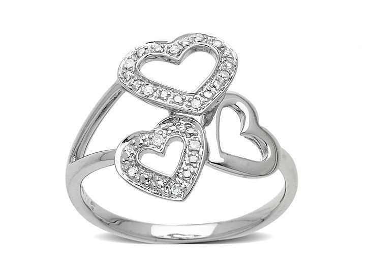 A perfect ring for your first love... whether you just met her last week, or met her 50 years ago. Or, a perfect pairing with the heart pendant that milady already owns. This charming ring of 10K white gold tops your finger with a gorgeous array of hearts dazzled with diamond accents. $107