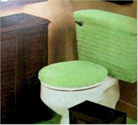 Fuzzy toilet seat, tank covers, and rugs. With matching toilet paper to set it all out so nice and purdy.