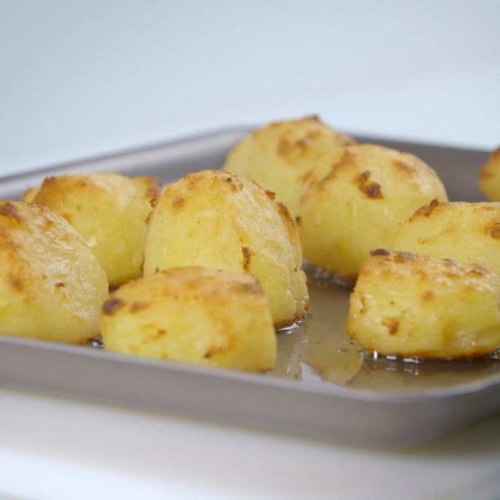 A picture of Delia's Perfect Roast Potatoes recipe. - Excellent recipe (also easy) but we just use a couple of large cast iron skillets or dutch ovens (no lid after adding potatoes). Adding some garlic really shines as well - Brandon