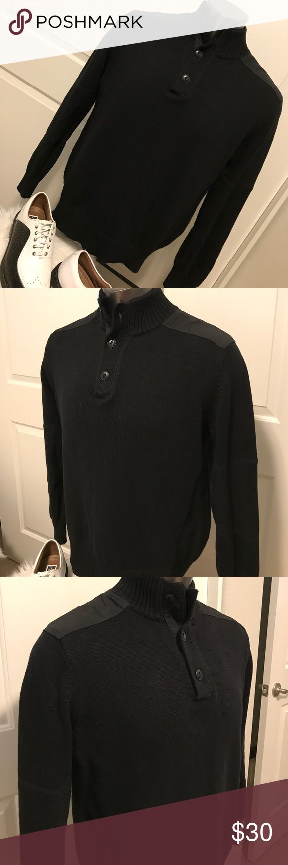 CONVERSE Men's Black Knit Mock Turtle Neck Sweater Beautiful black mock turtleneck pullover sweater. Features a three button top opening and two canvas fabric shoulder tabs. Panel stitched long sleeves. Great with jeans for the night out. Converse Sweaters