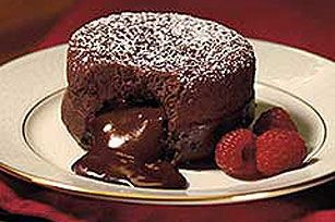 Dark chocolate molten cake,serve with vanilla ice cream on top!