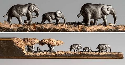 A Miniature Landscape Of Elephants Carved From The Tip Of A Pencil By Cindy Chinn