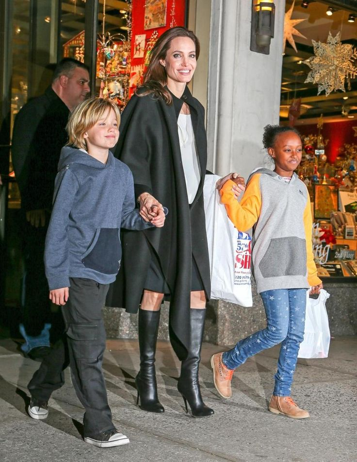 Angelina Jolie and kids Shiloh Jolie-Pitt (left) and Zahara Jolie-Pitt leave Lee's Art Shop in Manhattan.