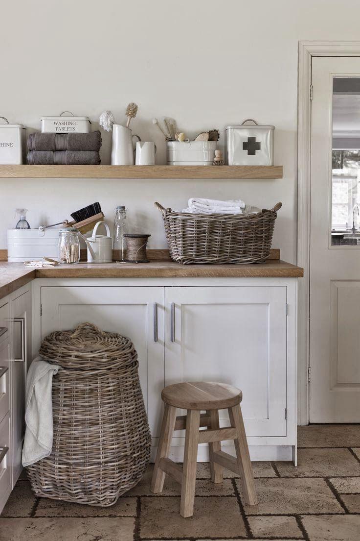 colour scheme: white cupboards, wood counter, grey tiles
