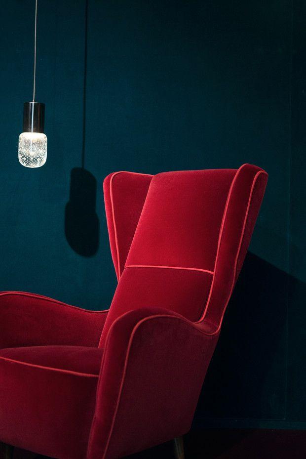 Dark | Interiors | Black | Decor | Red | a chair | Inside Nilufar Gallery in Milan