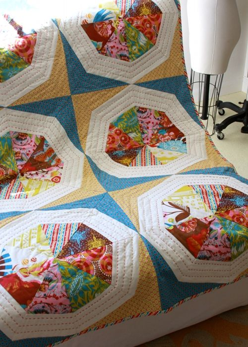 Perfect for scrap-busting.   AMH spinning stars quilt - free downloadable pattern