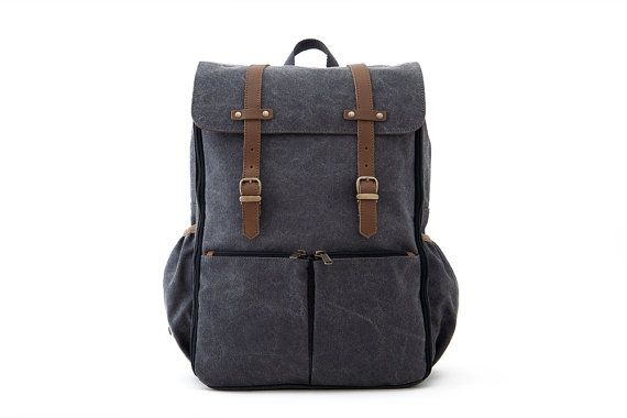 It features TWO ways of carrying: * Dual-use multi-pocketed baby bag * Full daily backpack (fitting 15in laptop) * Full weekender backpack  MATERIALS: * 14 oz cotton canvas * 100% full grain leather * Water-resistant canvas (Coated with Polyurethane on inner side for water resistance) * Solid brass hardware  DETAILS: * Secure antique brass magnetic-clasp closure * Solid YKK brass zipper closure with storm flap for added security * 2 zip exterior front YKK zip pockets, 2 side bottle holder…