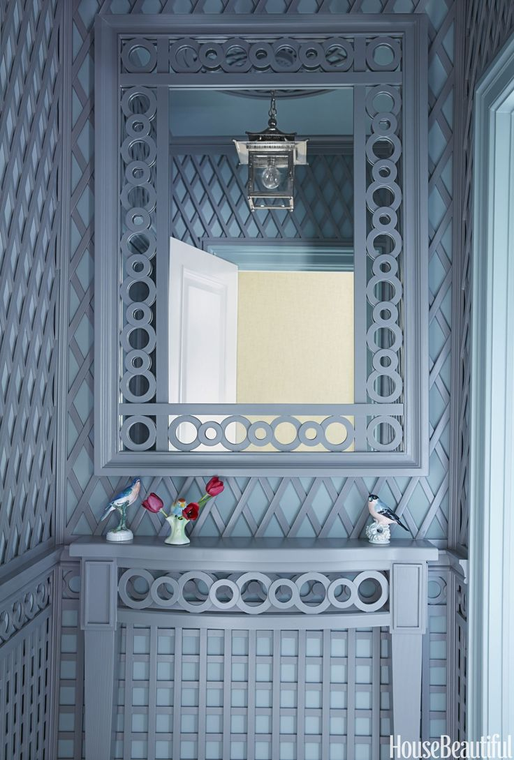 Chinoiserie meets orangery in the trellis-accented powder room, with millwork by Philippe Le Manach of Accents of France. The walls are painted in Dix Blue and treillage in Plummett, both by Farrow & Ball. The lantern above is from Charles Edwards.   - HouseBeautiful.com