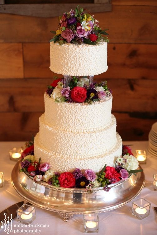 wedding cakes with pillars and flowers four tier wedding cake with pillars fireseed catering 26078