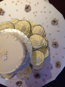 Wedding cake, cupcakes, confetti and flower decorations all hand made