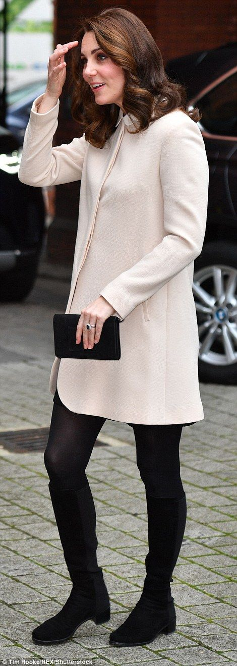 Kate swapped her heels for a pair of her trusty black knee high boots...