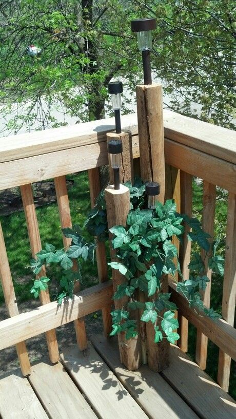 Today I made 2 of these for our deck. Made out of landscape timber, a 4x4 in the center to screw the timbers to, inexpensive solar lights, and artificial ivy...my cost $8 for the 8 lights, the rest we had around the house :)