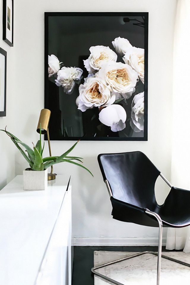 Minimalist Living Room Nook With A Black Leather Armchair Floral Print And