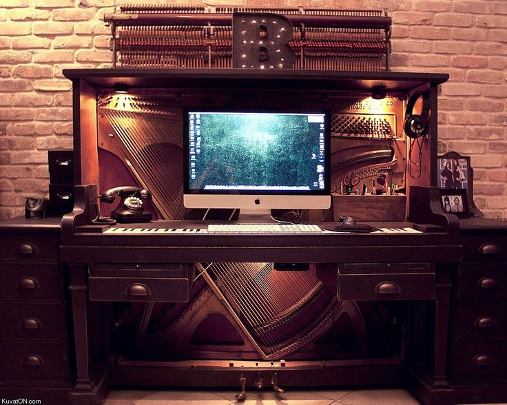 Wow! The coolest thing I've seen in a while. A computer desk made out of an old piano