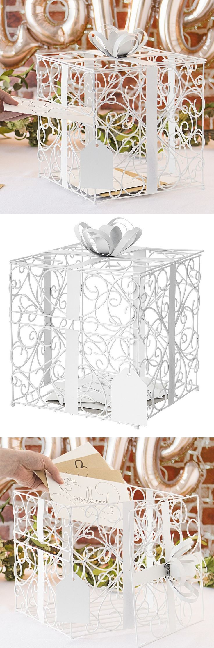 White Wedding Decor Idea - This matte white finish scrolled wire gift card box will be an attractive accent to any wedding reception theme. Fashioned to look like a gift-wrapped box, complete with wide metal ribbon band, bow, and dangling gift tag, this wedding card box will add interest, and dimension to the wedding gift card station while matching perfectly with any wedding color palette.