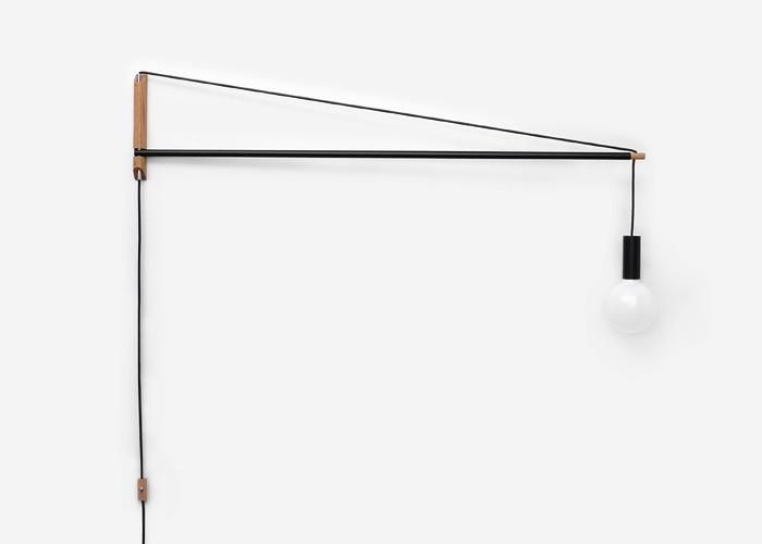 Up-and-coming Ohio-based designer Andrew Neyers 5-Foot Crane Light pivots 180 degrees with a cord tension cantilevered design and is adjustable to any height by feeding the cable through the pivoting rod; $225 at Consignd.