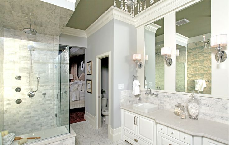 Luxurious Ensuite with a double vanity, walk-in shower, soaker tub, and a chandelier! The Harlowe in Lethbridge AB