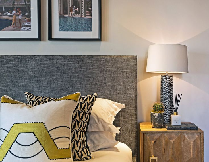 Creating intrigue and warmth, we layered depths of pattern into our London bedroom design, the geometric motifs acting as the perfect backdrop for the eye-catching Larsen Ohio fabric cushion in golden yellow.