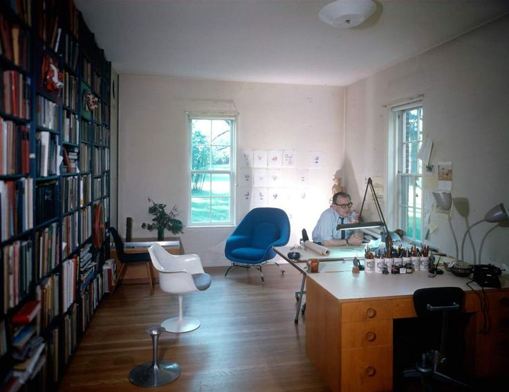 Eero Saarinen Working At His Desk Alongside The Womb Chair And Tulip Arm  Chair He Designed