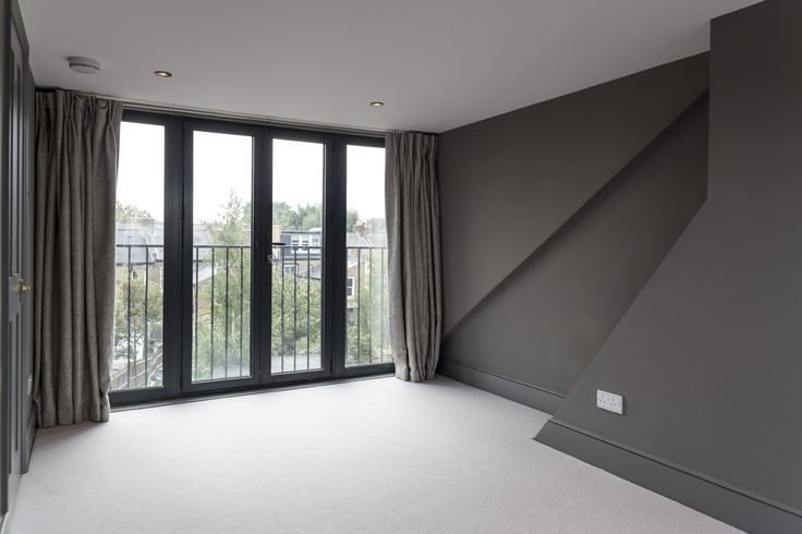 A fantastic rear dormer loft conversion with grey walls for a dramatic, modern look.