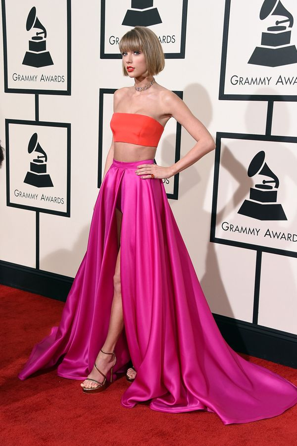 Taylor Swift at the Grammy Awards. Dressed in Versace pink skirt with split, coral crop top and matching lipstick
