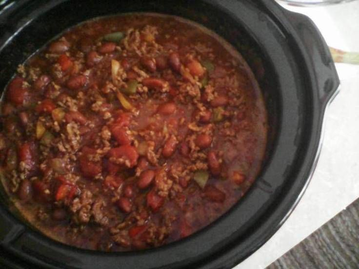 "Crock Pot Chili (easy)! ""Easy, slow cooked chili...mild or hot, topped with…"