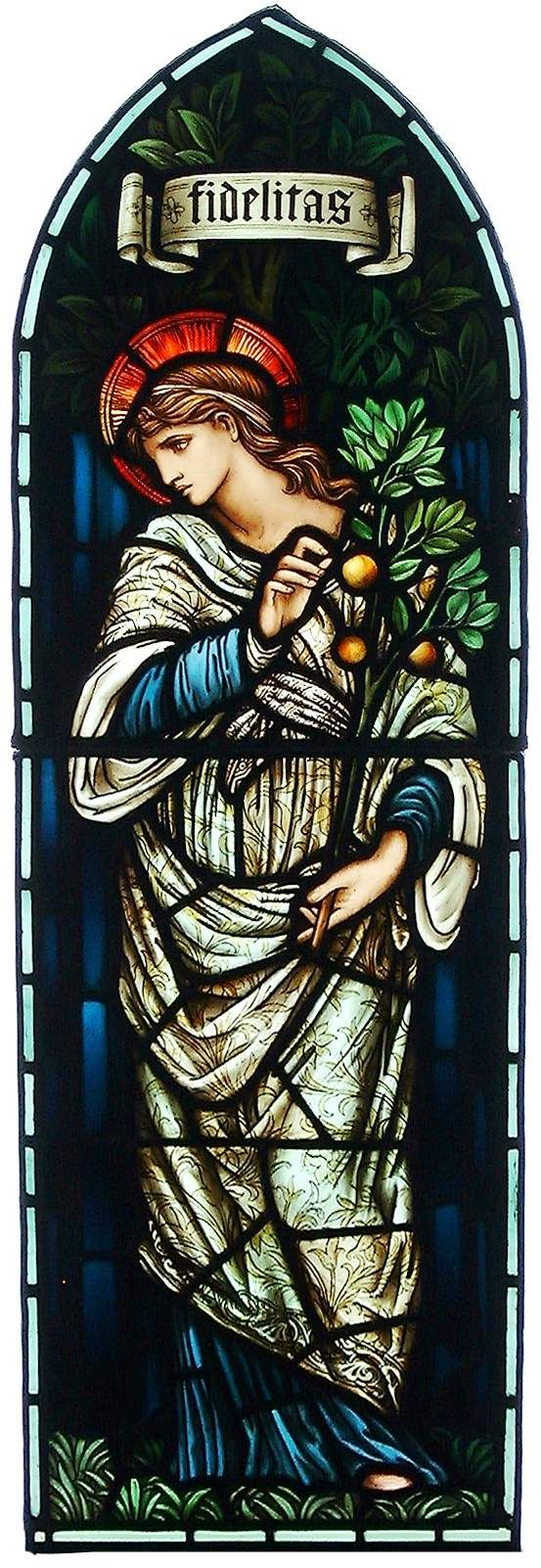 Two-panel light of Fidelitas designed by Edward Burne-Jones and made by Morris and Company 1910-1912. Fidelitas, face in profile and in richly patterned robe, holding leafy branch with fruits. Foliage and inscribed scroll above.