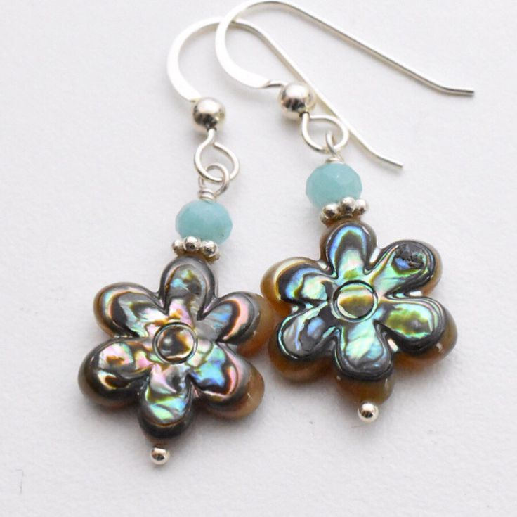 Pretty paua shell flower earrings. Accented with blue agate and Sterling silver. A great gift for Valentine's day, #theseflowerswontdie ! . . . #pauashell #pauashelljewelry #sunlightsilver.etsy.com #flowers #flowersthatdontdie #giftforher #flowerearrings #flowerjewelry #shelljewelry #pauashellearrings #earrings #peacockcolors#jewellry #jewelry #handmadejewelry #valentinesdaygiftideas #colorfuljewelry #brightcolors  !