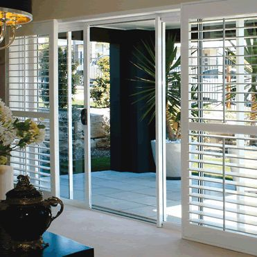 Plantation shutters on sliding doors. Beach house inspo