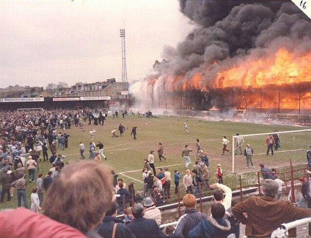 Bradford Valley Parade stadium fire. May 11 1985. A bumper crowd of 11,000 turned out to celebrate the host club match against Lincon City. A council report just a year earlier proved tragically prescient. It warned that the build-up of litter was a possible risk, even stating that it could be ignited by a dropped cigarette. The club had no legal obligation to heed the council's warning and the rubbish was not cleared away. 56 people died in the blaze.