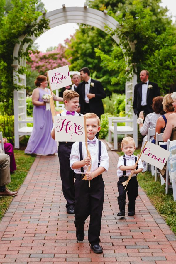 Give cute page boys and flowergirls signs to carry down the aisle. Steven and Lily Photography