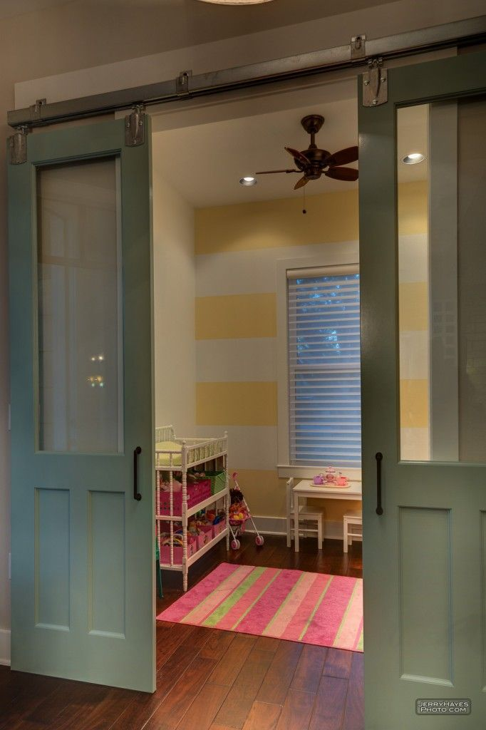 "Sliding barn style doors. ikea sells this system. great way to portion off or ""hide"" a small room/nook."