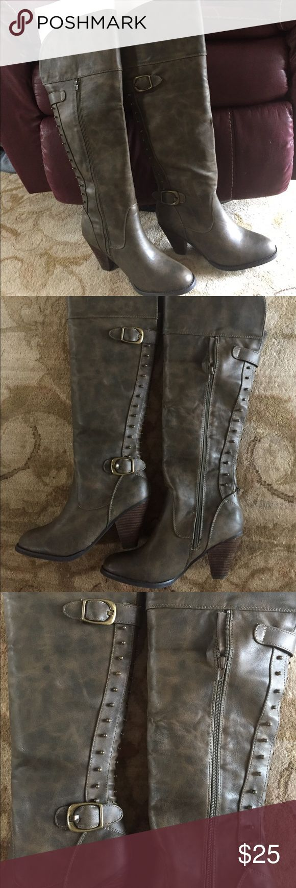 Brown Not rated boots Khaki Brown not rated boots.  Never worn zipper sides, studs on back.  Top of boot can fold over about 2 inch heel.  Called Sweet surrender Not Rated Shoes Heeled Boots